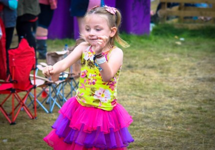 Scarlett-dressed-in-a-tutu-dancing-at-the-festival-arena-430x300