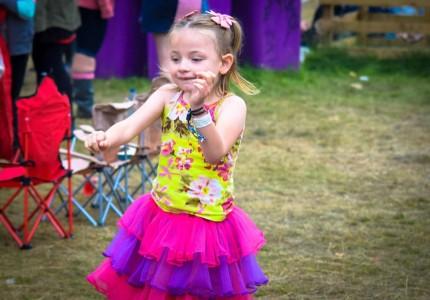 Scarlett-dressed-in-a-tutu-dancing-at-the-festival-arena-430x300