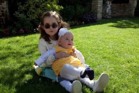 ellie-sat-on-the-grass-with-her-younger-sister