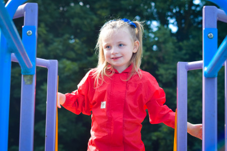 scarlett-in-red-suit-at-top-of-slide