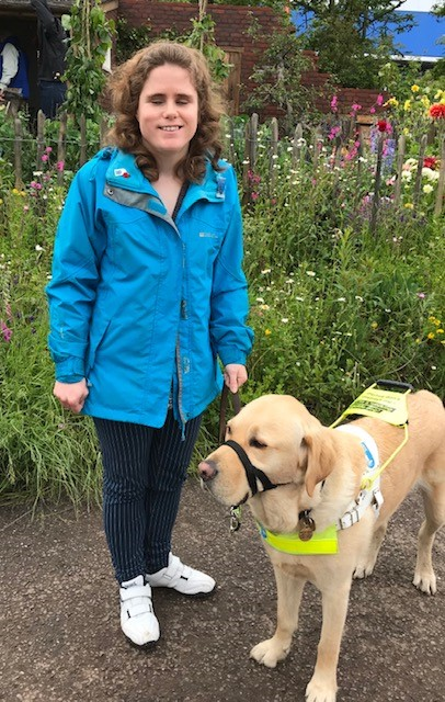 Harriet with guide dog Sparky in a garden