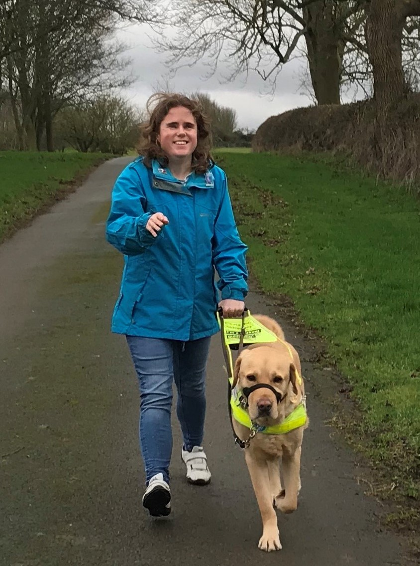 Guide dog Sparky and Harriet on a walk