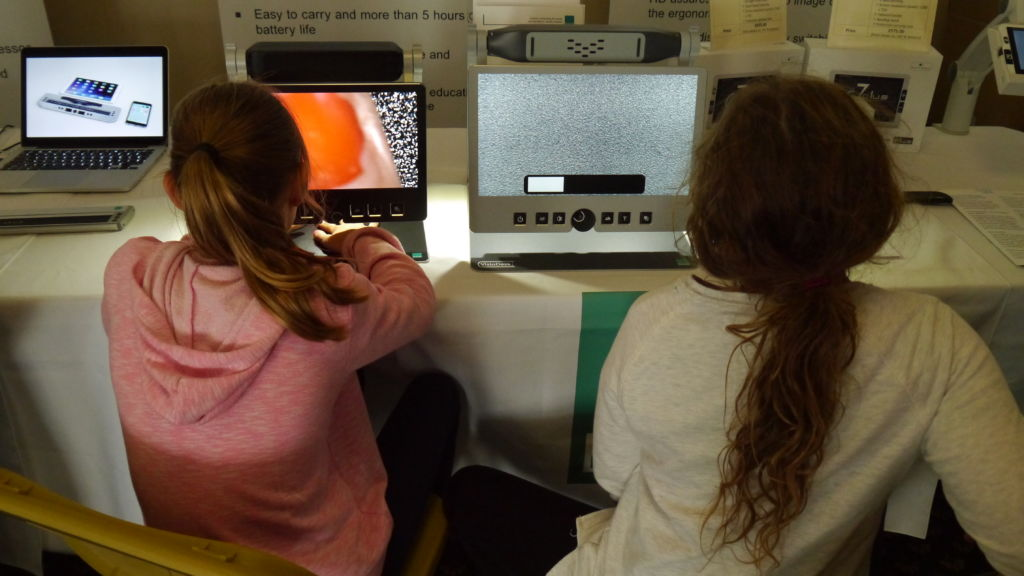 Two girls using assistive technology