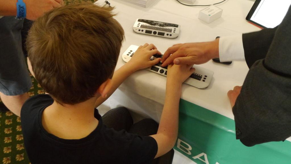 Boy using a braille display