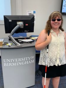 Emma next to a University of Birmingham sign