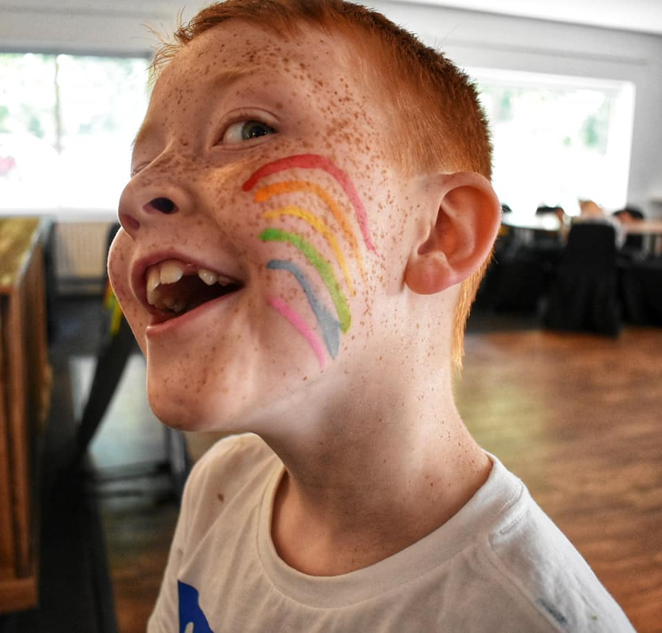 Sonny with rainbow facepaint