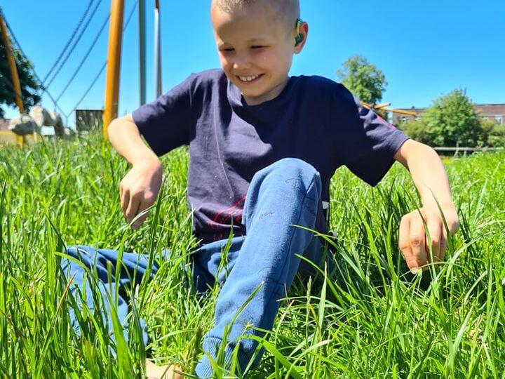 cam sat on grass